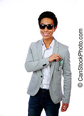 Portrait of a happy asian man over white background