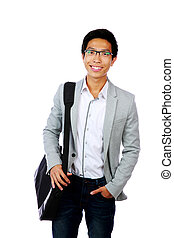 Portrait of a happy asian man standing with briefcase over white background