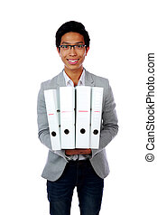 Portrait of a happy asian man with folders over white background