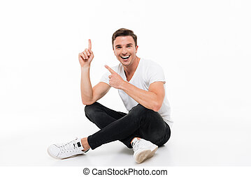 Portrait of a happy attractive man in white t-shirt