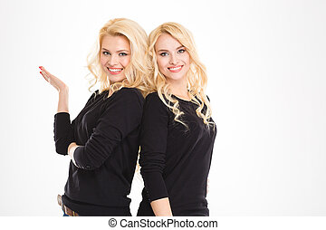 Portrait of a happy blonde twins sisters