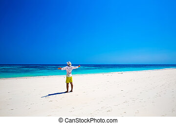Portrait of a happy carefree man smiling with arms open outdoors portrait, human enjoying life on tropical freedom beach. Success. Enjoyment.
