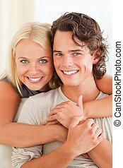 Portrait of a happy couple embracin