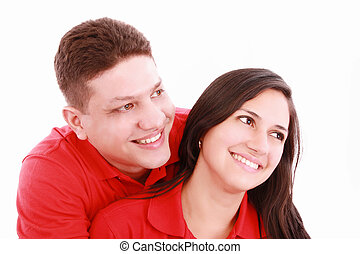Portrait of a happy couple hugging each other and looking away - Copyspace