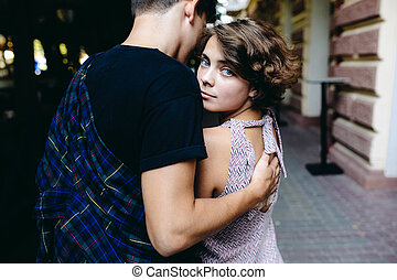 couple hugging in the street