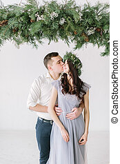 Portrait of a happy couple laughing at camera. Bridesmaid and groomsman kissing