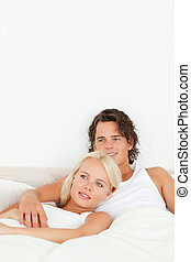 Portrait of a happy couple lying on a bed