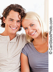 Portrait of a happy couple sitting