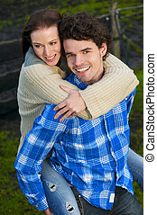 Portrait of a Happy Couple Smiling Outdoors