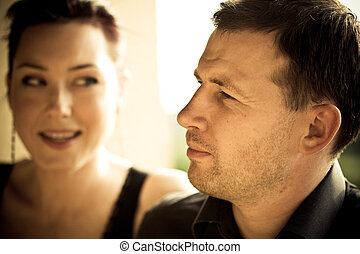 Portrait of a happy couple with vigneted dark corners and vintage sephia look