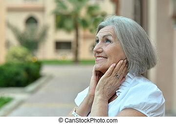 elderly woman at tropical resort