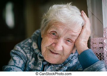 Portrait of a happy elderly woman close-up. Age 90 years old.