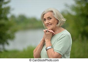 Portrait of a happy elderly woman posing