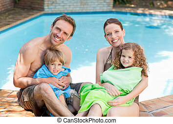 Portrait of a happy family beside t