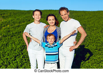 Portrait of a happy family in summer nature.