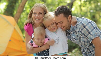 Portrait of a happy family that smiling, laughing and looking at the camera