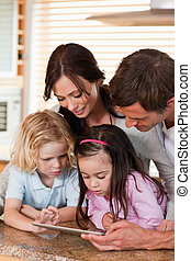 Portrait of a happy family using a tablet computer together