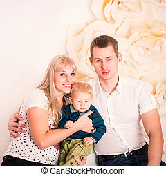 Portrait of a happy family with baby