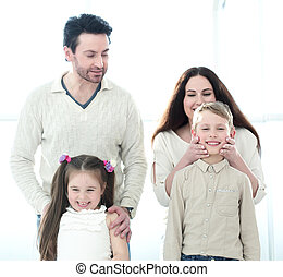 portrait of a happy family with small children