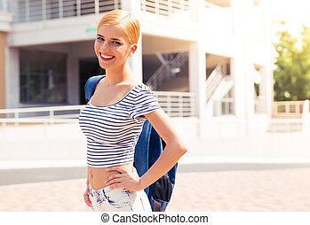 Portrait of a happy female student with backpack