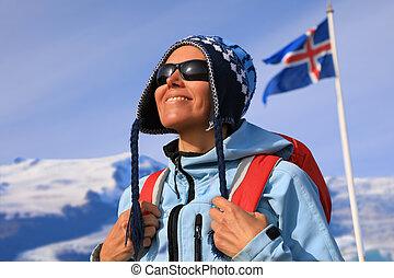 Portrait of a happy female tourist