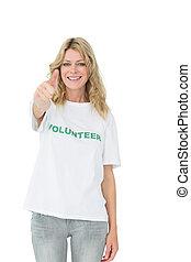 Portrait of a happy female volunteer gesturing thumbs up
