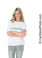 Portrait of a happy female volunteer with arms crossed