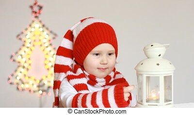 Portrait of a happy funny child in Santa Claus clothes. A...