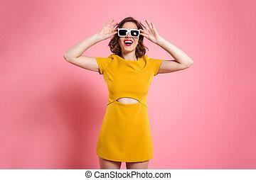 Portrait of a happy girl in sunglasses