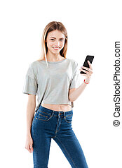 Portrait of a happy girl standing and holding mobile phone