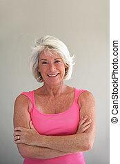 Portrait of a happy-go-lucky elderly woman