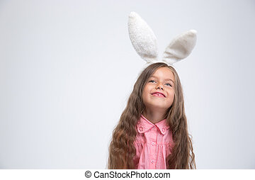 Portrait of a happy little girl with bunny ears