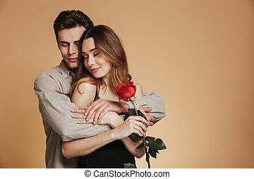 Portrait of a happy loving couple hugging