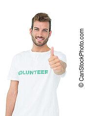 Portrait of a happy male volunteer gesturing thumbs up