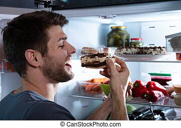 Happy Man Eating Cake