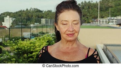 Portrait of a Happy Mature Senior Lady Smiling at the Camera