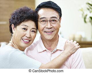 portrait of a happy senior asian couple