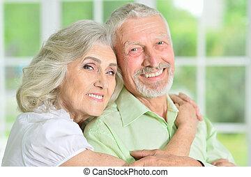 portrait of a happy senior couple hugging