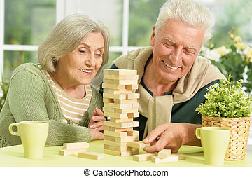 senior couple playing in table game
