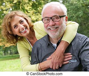Portrait of a happy senior couple smiling outdoors