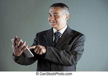 Portrait of a happy senior man using a tablet PC