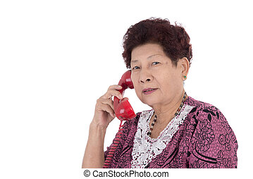 portrait of a happy senior woman talking on telephone over white background