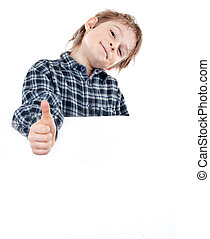 Portrait of a happy small boy holding a blank board against white background