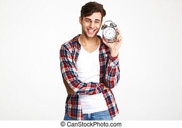 Portrait of a happy smiling man showing alarm clock