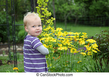 Portrait of a happy toddler in the garden