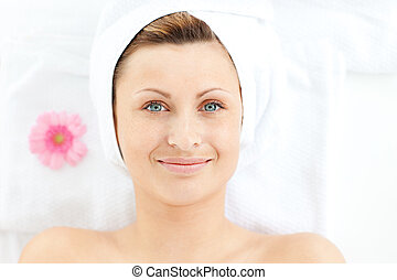Portrait of a happy woman in a spa center