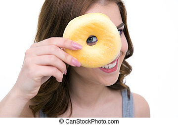 Portrait of a happy woman looking at the camera through donut