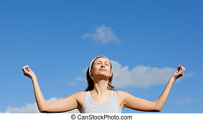 Portrait of a happy woman meditatin