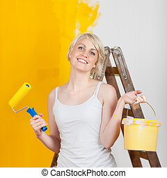happy woman with paint tools