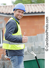 portrait of a happy worker showing thumb up